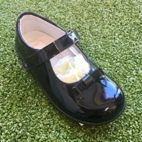 Black patent leather girls shoe with velcro fastening. Bow detail at the front. Soft leather padded insole for comfort.