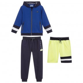Made in stretch jersey, Mayoral have designed this three piece tracksuit in navy blue, royal blue and bright yellow, with the words 'It's sport and fun' and 'sporty line'. The zip-up jacket has a cosy, lined hood and the trousers and shorts have an elasti