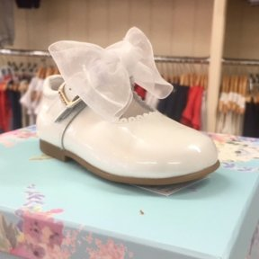 Andanines White patent leather bow mary-jane shoes