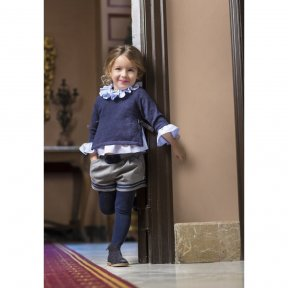A stunning 4 piece set for girls. The navy jumper has a fleck through it with bows at either side, which goes over the top of a light blue ruffle blouse. Paired with grey shorths and cute navy tights.