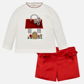 Mayoral baby girls red shorts and top set . The soft ivory cotton jersey top has a sweet velvet and felt house on the front. The red velvet shorts have pretty frill detail, and an elasticated, adjustable waist. A/W18 2210