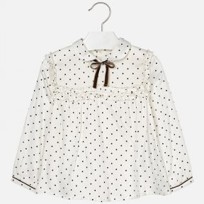 Mayoral mini long sleeved cream blouse with a brown polka dot pattern, buttoned cuffs and shirt collar. There is a  button fastening to the back, a ruffled detail across the chest and bow to the neckline. A/W18 4122