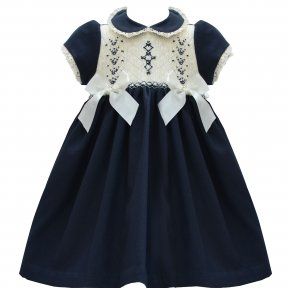 Pretty Original navy and cream long dress. Fully lined with button up fastening to the back. Thick navy material with smocking detail to the chest. Built in belt with 2 cream bows to the front. Lace detailing to collar and short sleeves.
