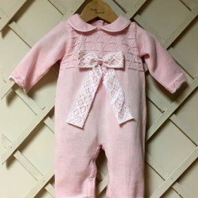 Pretty Originals 2 piece pink trouser set. Knitted top with back popper fastening and pretty lace bow embellishment. Scalloped edge to hem sleeves. Matching trousers with scalloped ankles and elasticated waist.