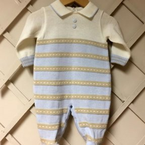 Pretty Originals boys knitted baby-grow. Baby blue and beige stripped pattern with button details to the front. Popper fastening to back and between the legs.