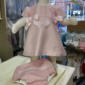 Pretty Originals pale pink 2 piece dress and jam-pants set. Fully line, full length button fastening to the back. Silver sparkle detail to the material. Lace embellishment to the capped sleeves and front. 2 large satin bows on the chest. Matching jam-pant