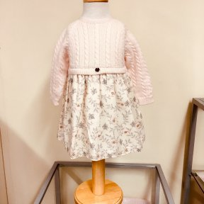 Wedoble girls soft peach winter dress. Cable knit long sleeved top with a soft cotton lined skirt. Floral fern print to the skirt. Full length button fastening to the back.