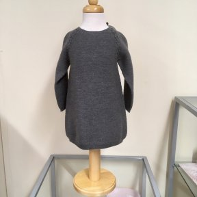 Wedoble girls fine knit dark grey wool jumper dress. Long sleeved. Half length button fastening to the back.