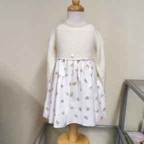 Wedoble girls winter dress. Soft cream knitted top with a fully lined cream skirt, Gold sparkle print to the skirt. Full length button fastening to the back.