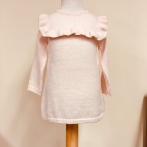 Wedoble girls soft peach jumper dress. Fine knit with a frill detail to the yoke. 2 button fastening to the back.