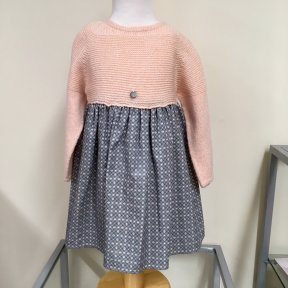 Wedoble girls knitted winter dress. Soft grey knitted long sleeved top. Lined cream skirt with grey rabbit print. Full length button fastening to the back.