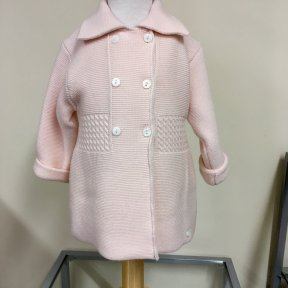 Wedoble soft peach knit pram coat. Merino wool (this yarn has been treated to allow machine washing). Double breasted 6 button fastening to the front.