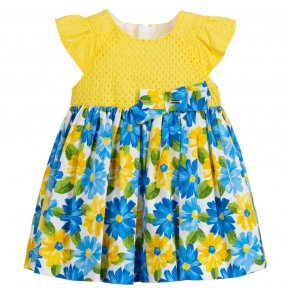Younger girls yellow and blue dress from Mayoral. The bodice is made in soft cotton lace and the full floral skirt in lightweight cotton. It is fully lined in cotton, with ruffle sleeves and a bow on the waist.