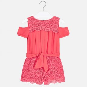 Off the shoulder playsuit for girls. Round neckline. fastening on the back with an invisible zip. Elastic waistband. Made from a mix of carefully selected fabrics, combined to create a different, unique design. Decorative ribbon on the waist.