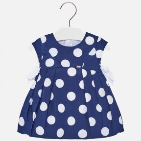 Short sleeved dress. Round neckline. Fitted to the chest. Opening on the back with an invisible zip. Made from comfortable poplin fabric, which is both easy care and durable. Pleated design. Decorative elements: applique bows. Polka-dot pattern. Fully lin