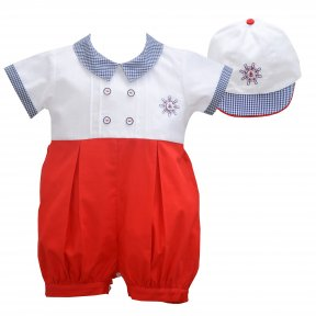 A red and white shortie set for younger boys by Pretty Originals, with classic navy gingham trims. This lovely set is made from soft, lightweight cotton twill and includes a nautically inspired shortie with cute anchor embroidery and a matching cotton hat