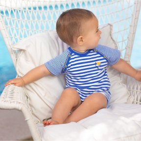 Striped jersey short sleeved romper with decorations on the armholes.