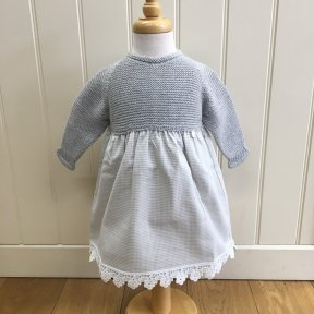 Floc dress with grey knitted top and gingham material skirt which is fully lined and has a flower trim to the hem