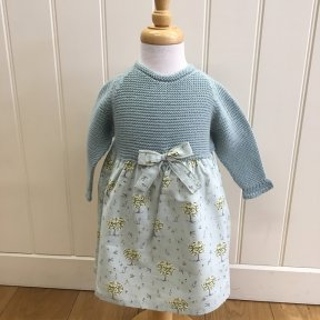 Floc sage green knitted dress with a patterned material skirt which is fully lined. this dress has a bow detail to the front. 306594