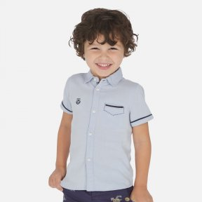 Mayoral sky blue short sleeved shirt with, button fastenings down the front. front pocket detail & Mayoral motif, 100% cotton 3163