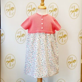 Floc baby girls pink knitted short sleeved dress, patterned material skirt, button front fastening.