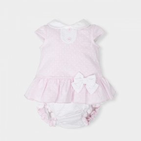 Tutto Piccolo little girls pink and white spotted dress and pant set with bow details.